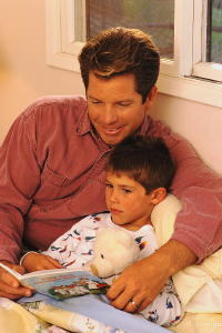father reading to son Copyright © Corbis