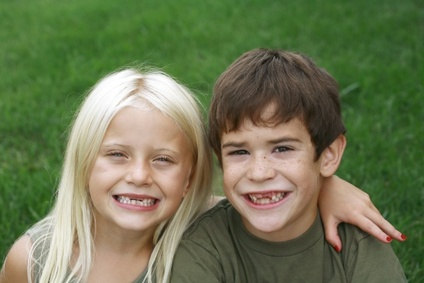 toothless boy and girl missing front teeth