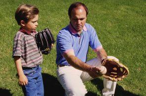 Father & son playing baseball photo